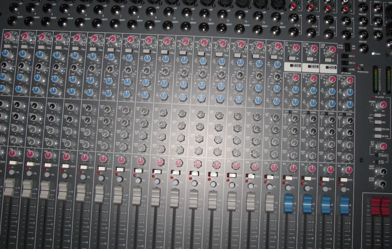 This is what a mixing board looks like before you spill drinks all over it.